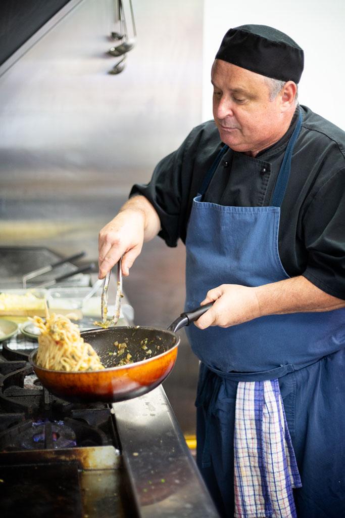 Aldo tossing the spaghetti.