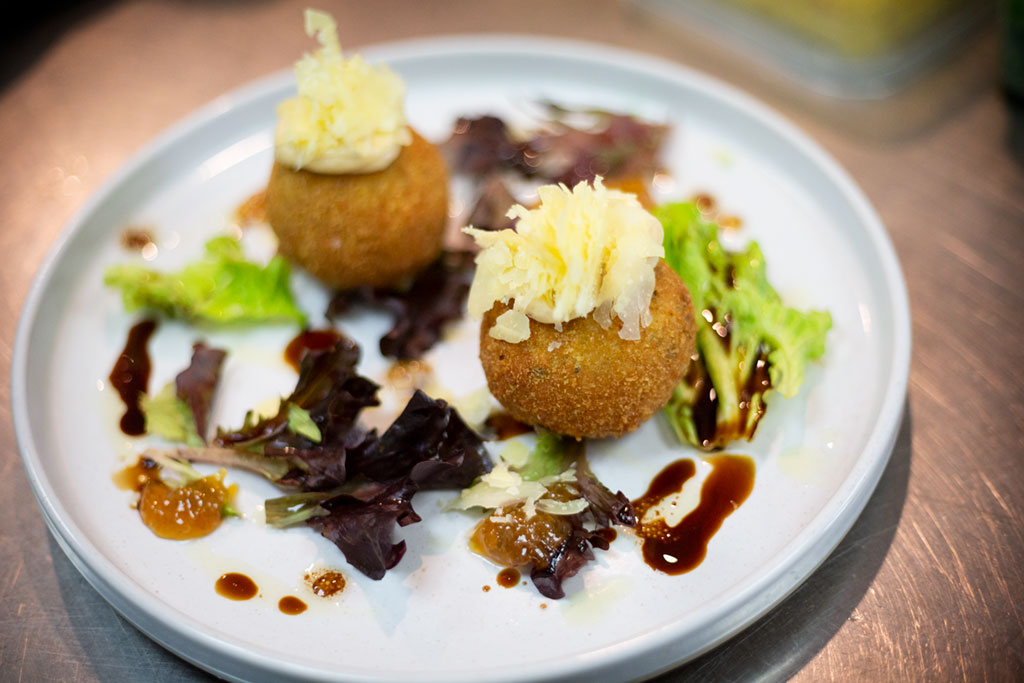 Crumbed rice balls with four cheeses, garlic & herbs