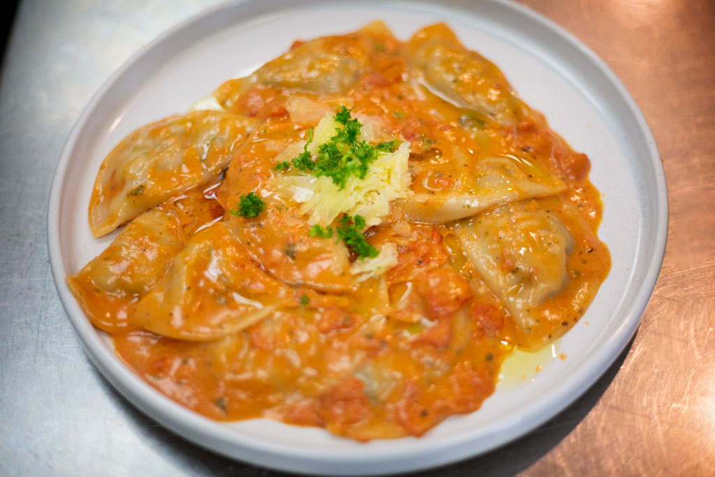 Our hand made ravioli with ricotta, mixed meat, spinach and cheese.